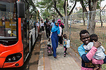 28 August 2019, Jakarta, Indonesia: - African refugees from Somalia and Ethiopia lining up to board a bus outside the UNHCR refugee centre in Kalideres, Jakarta. Plans to re-locate the overcrowded refugees have been fast tracked after a fight broke out between the groups, many of whom have been in Indonesia for years waiting for placement. Tensions ran high between Afghan and African groups in the centre with a lack of adequate food for the refugees being the catalyst. The African groups, who were moved onto the footpath, were being bussed out today. Conditions in the centre are grim and the local Indonesian population not happy with the refugees presence in the suburb.Picture by Graham Crouch/The Australian