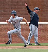 Virginia outfielder Joe McCarthy (31) rounds third base as he prepares to score under the direction of associate head coach Kevin McMullan in the first inning of an NCAA college baseball tournament super regional game in Charlottesville, Va., Sunday, June 8, 2014. Virginia defeat Maryland 7-3. (AP Photo/Andrew Shurtleff)