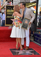 LOS ANGELES, CA. August 11, 2016: Mark Burnett &amp; Roma Downey at Hollywood Walk of Fame Star ceremony for actress Roma Downey. <br /> Picture: Paul Smith / Featureflash