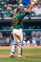 Yasmani Grandal #24 of the Miami Hurricanes lets his defense know there is one out against the Boston College Eagles at the 2010 ACC Baseball Tournament at NewBridge Bank Park May 27, 2010, in Greensboro, North Carolina.  The Eagles defeated the Hurricanes 12-10 in 10 innings.  Photo by Brian Westerholt / Four Seam Images