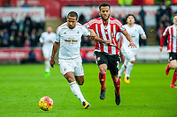 Wayne Routledge of Swansea City  ( left ) in action during the Barclays Premier League match between Swansea City and Southampton  played at the Liberty Stadium, Swansea  on February 13th 2016