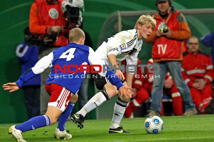 L&permil;nderspiel<br /> WM 2010 Qualifikatonsspiel Qualificationmatch Leipzig 28.03.2009 Zentralstadion Gruppe 4 Group Four <br /> <br /> Deutschland ( GER ) - Liechtenstein ( LIS )<br /> <br /> Marcell Jansen (#3 Hamburger SV HSV Deutsche Nationalmannschaft) und Yves Oehri (#4 Liechtenstein Nationalmannschaft).<br /> <br /> Foto &copy; nph (  nordphoto  )<br />  *** Local Caption ***