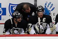 PITTSBURGH, PA - NOVEMBER 21:  Sidney Crosby #87 of the Pittsburgh Penguins talks with head coach Dan Bylsma and teammate Chris Kunitz #14 in the first period against the New York Islanders during the game on November 21, 2011 at CONSOL Energy Center in Pittsburgh, Pennsylvania. Crosby has not played a game since January 5th after sustaining a concussion.  (Photo by Jared Wickerham/Getty Images)