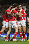 Jamie Roberts and Mike Phillips celebrate with Alex Cuthbert after the Welsh wing scores the first try of the match..RBS 6 Nations 2012.Wales v Scotland.Millennium Stadium.12.02.12.Credit: Steve Pope - Sportingwales