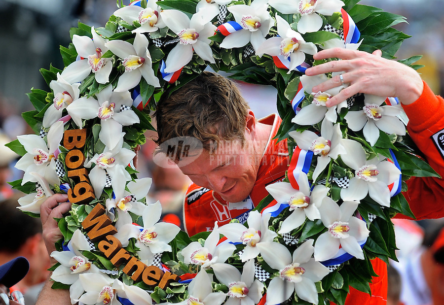 May 25, 2008; Indianapolis, IN, USA; IRL driver Scott Dixon celebrates after winning the 92nd running of the Indianapolis 500 at the Indianapolis Motor Speedway. Mandatory Credit: Mark J. Rebilas-