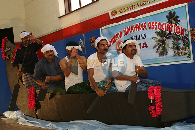 Sumant, Yeshudas, Thomas, Polly and Ullas perform the traditional Snake Boat Race at the Drogheda Malayali Association Onam Festival in Mell NS...Photo NEWSFILE/Jenny Matthews.(Photo credit should read Jenny Matthews/NEWSFILE)....This Picture has been sent you under the condtions enclosed by:.Newsfile Ltd..The Studio,.Millmount Abbey,.Drogheda,.Co Meath..Ireland..Tel: +353(0)41-9871240.Fax: +353(0)41-9871260.GSM: +353(0)86-2500958.email: pictures@newsfile.ie.www.newsfile.ie.FTP: 193.120.102.198.