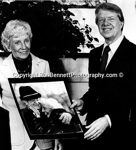Muriel Humphrey and President Jimmy Carter in the oval office of the White House look at a photograph taken by UPI White House Photographer Ron Bennett, Muriel and Hubert Humphrey had returned from Camp David Maryland Hubert Humphrey died of cancer shortly after the picture was taken,