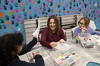 Evenees Corona, 11, (left) shows her art piece to Hayden Bridger, 11 (from second left) and Bria Farrell, 11, Thursday, January 9, 2019 at the Boys and Girls Club in Bentonville.<br /> <br /> Thursday was national law enforcement appreciation day. Kids at the Boys and Girls Club made coloring sheets and wrote thank you notes to show appreciation for law enforcement. They will send some of the best ones to the Bentonville police department. Check out nwaonline.com/200110Daily/ for today's photo gallery.<br /> (NWA Democrat-Gazette/Charlie Kaijo)