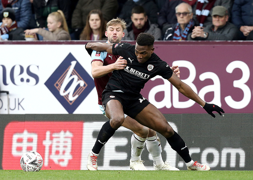Barnsley's Dimitri Cavare holds off the challenge from Burnley's Charlie Taylor<br /> <br /> Photographer Rich Linley/CameraSport<br /> <br /> Emirates FA Cup Third Round - Burnley v Barnsley - Saturday 5th January 2019 - Turf Moor - Burnley<br />  <br /> World Copyright © 2019 CameraSport. All rights reserved. 43 Linden Ave. Countesthorpe. Leicester. England. LE8 5PG - Tel: +44 (0) 116 277 4147 - admin@camerasport.com - www.camerasport.com