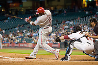 Philadelphia Phillies first baseman Ryan Howard #6 swings during the Major League Baseball game against the Houston Astros at Minute Maid Park in Houston, Texas on September 14, 2011. Philadelphia defeated Houston 1-0 to clinch a playoff berth.  (Andrew Woolley/Four Seam Images)