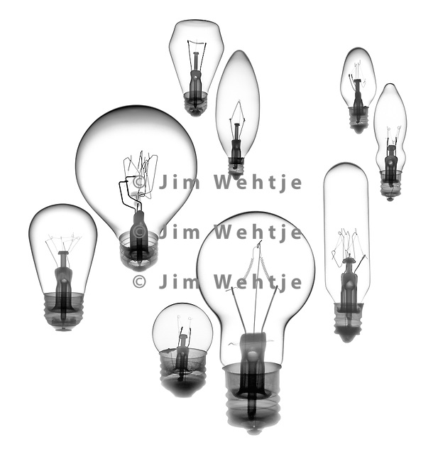 X-ray image of nine incandescent bulbs (black on white) by Jim Wehtje, specialist in x-ray art and design images.