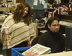 Theresa Vargas and Eli Reyes in cityroom of Newsday Melville office on Saturday March 26, 2005. (Photo Jim Peppler 2005).