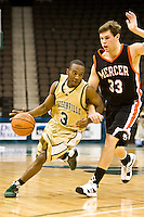 January 9, 2009:     Jacksonville guard Ben Smith (3) drives around Mercer's Daniel Emerson (33) in Atlantic Sun Conference action between the Jacksonville Dolphins and the Mercer Bears at Veterans Memorial Arena in Jacksonville, Florida.  Jacksonville defeated Mercer 80-59.