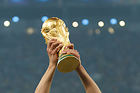 The hand of Benedikt Howedes of Germany as he lifts the World Cup trophy after winning the 2014 final