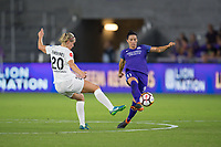 Orlando, FL - Saturday March 24, 2018: Orlando Pride defender Ali Krieger (11) plays the ball away before the challenge by Utah Royals forward Elise Thorsnes (20) during a regular season National Women's Soccer League (NWSL) match between the Orlando Pride and the Utah Royals FC at Orlando City Stadium. The game ended in a 1-1 draw.
