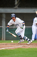 Princeton Rays second baseman Jake Palomaki (1) runs to first base after laying down a bunt during the second game of a doubleheader against the Greeneville Reds on July 25, 2018 at Hunnicutt Field in Princeton, West Virginia.  Greeneville defeated Princeton 8-7.  (Mike Janes/Four Seam Images)