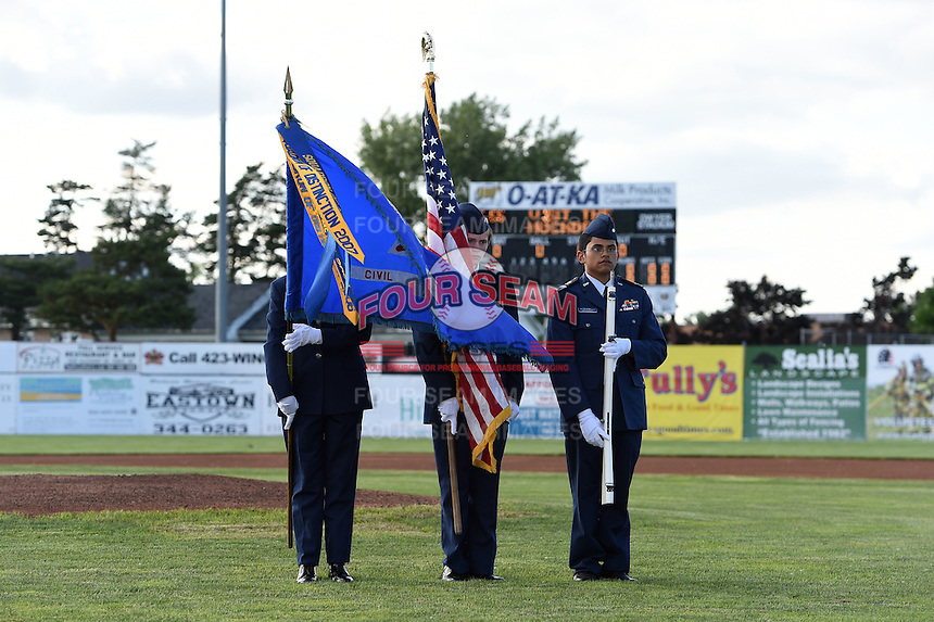 Batavia Muckdogs national anthem flag presentation before a game against the Auburn Doubledays on June 14, 2014 at Dwyer Stadium in Batavia, New York.  Batavia defeated Auburn 7-2.  (Mike Janes/Four Seam Images)