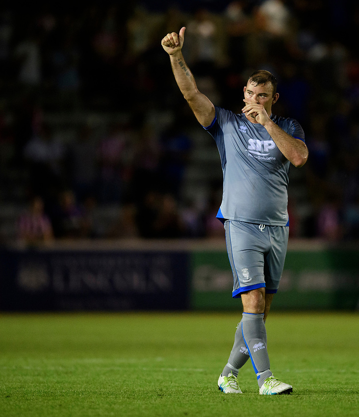 Lincoln City's Matt Rhead acknowledges the fans at the end of the game<br /> <br /> Photographer Chris Vaughan/CameraSport<br /> <br /> Football Pre-Season Friendly - Lincoln City v Stoke City - Wednesday July 24th 2019 - Sincil Bank - Lincoln<br /> <br /> World Copyright © 2019 CameraSport. All rights reserved. 43 Linden Ave. Countesthorpe. Leicester. England. LE8 5PG - Tel: +44 (0) 116 277 4147 - admin@camerasport.com - www.camerasport.com