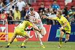 Ruaridh McConnochie of rnx runs with the ball while Australian players try to stop him during the match Australia vs England, the Bronze Final of Day 2 of the HSBC Singapore Rugby Sevens as part of the World Rugby HSBC World Rugby Sevens Series 2016-17 at the National Stadium on 16 April 2017 in Singapore. Photo by Victor Fraile / Power Sport Images