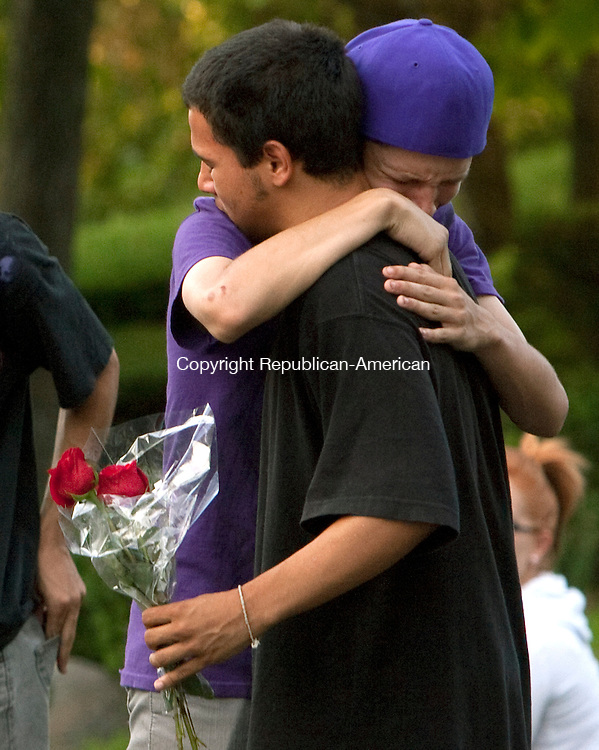 WATERBURY, CT 18  JULY, 2010-07180JS07-Friends comfort each other as friends and family members garthered at the gates of Holy Land USA in Waterbury on Sunday for a candle light vigil to pay their respects for 16-year-old Chole Ottman whose body was discovered there on Saturday. Waterbury police have charged Francisco Cruz, 19, with her murder. <br /> Jim Shannon Republican-American