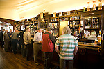 Customers standing at the bar, The Grill Bar, Aberdeen, Scotland