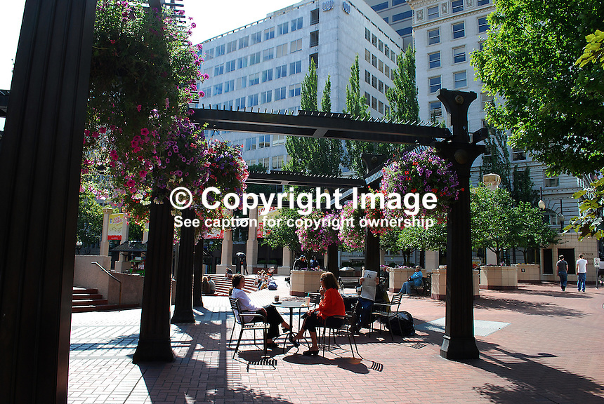 Relaxing in the sunshine, Pioneer Square, Downtown, Portland, Oregon, USA, people, flowers, hanging baskets, 200808300670..Copyright Image from Victor Patterson, 54 Dorchester Park, Belfast, N Ireland, BT9 6RJ...Tel: +44 28 9066 1296.Mob: +44 7802 353836.Email: victorpatterson@mac.com..IMPORTANT: Please go to www.victorpatterson.com and click on my Terms and Conditions of use.