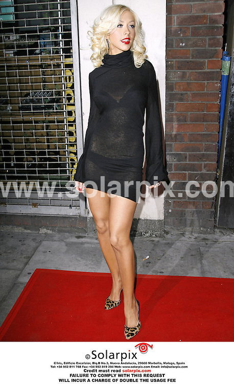 """ALL ROUND PICTURES FROM SOLARPIX.COM..Christina Aguilera arrives for her showcase to promote her new album, """"Back To Basics"""" at Koko in Camden, north London on 20.07.06.  Job Ref: 2608/PRS..MUST CREDIT SOLARPIX OR DOUBLE USAGE FEE CHARGED.."""