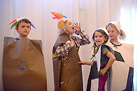 NWA Democrat-Gazette/BEN GOFF @NWABENGOFF<br /> Marshall Davis (from left), 8, Kelsey Hancock, 7, Sloan McQuade, 7, and Lucie Lebens, 6, take part in a thanksgiving sketch on Saturday Nov. 14, 2015 with other lower elementary students during Walnut Farm Montessori School's annual We Are Thankful celebration at Avondale Chapel in Bentonville.