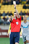Match referee Matthew Conger gives a yellow card to a Newcastle United player after an infringement with the Wellington Phoenix  in the fourth match of the Football United Tour at Westpac Stadium, Wellington, New Zealand, Saturday, July 26, 2014. Credit: Dean Pemberton