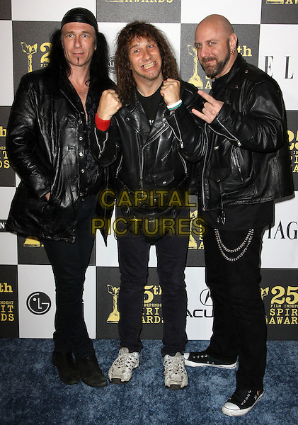GLENN FIVE, STEVE KUDLOW & ROBB REINER of ANVIL.25th Annual Film Independent Spirit Awards held At The Nokia LA Live, Los Angeles, California, USA,.March 5th, 2010 ..arrivals Indie Spirit full length black gold beige scarf dress  hands gesture leather jacket suit biker trainers silver chain chains .CAP/ADM/KB.©Kevan Brooks/Admedia/Capital Pictures
