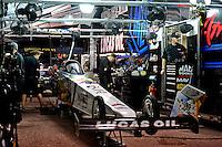 Jan. 17, 2013; Jupiter, FL, USA: Crew members work on the car of NHRA top fuel dragster driver Brandon Bernstein during testing at the PRO Winter Warmup at Palm Beach International Raceway.  Mandatory Credit: Mark J. Rebilas-