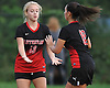 Natalie Ferretti #13 of Long Island Lutheran, left, congratulates Christina Loizou #10 after she scored a goal in a varsity girls soccer game against St. Dominic at Charles Wang Athletic Complex in Muttontown on Monday, Oct. 3, 2016. St. Dominic won by a score of 6-4.