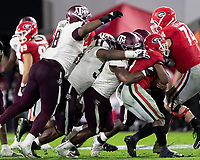 ATHENS, GA - NOVEMBER 23: Buddy Johnson #1, Justin Madubuike #52 and DeMarvin Leal #8 of the Texas A