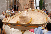 Mariachi wearing large Mexican sombrero at a wedding in San Miguel de Allende, Mexico