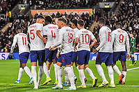 England Under 21's midfielder Phil Foden (10) with team mates after opening goal during the UEFA Euro U21 Qualifying match between England U21 & Kosovo U21 at KCOM Craven Park, Hull, England on 9 September 2019. Photo by Stephen Buckley / PRiME Media Images.