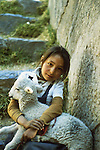 Mary Had a little Lamb, little Peruvian girl with her lamb at the ruins of Sachsasuwaman, Peru