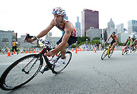 29 JUN 2014 - CHICAGO, USA - Adam Bowden (GBR) of Great Britain takes a corner on the bike during the elite men's ITU 2014 World Triathlon Series round in Grant Park, Chicago in the USA (PHOTO COPYRIGHT © 2014 NIGEL FARROW, ALL RIGHTS RESERVED)