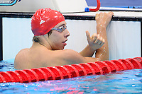 PICTURE BY ALEX BROADWAY /SWPIX.COM - 2012 London Paralympic Games - Day Five - Swimming, Aquatic Centre, Olympic Park, London, England - 03/09/12 - Jonathan Fox of Great Britain reacts after the Men's 100m Freestyle S7 Heats.