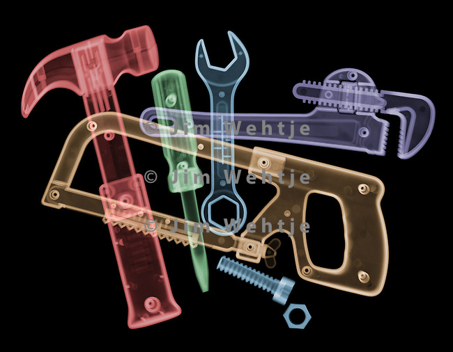 X-ray image of overlapping tools (color on black) by Jim Wehtje, specialist in x-ray art and design images.