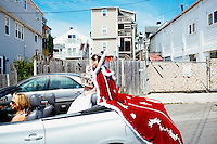 The Fiesta queen waits for the Sunday procession to start during St. Peter's Fiesta in Gloucester, Massachusetts, USA.