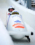 18 December 2010: Kaillie Humphries crosses the finish line, finishing in 9th place for Canada at the Viessmann FIBT World Cup Bobsled Championships on Mount Van Hoevenberg in Lake Placid, New York, USA. Mandatory Credit: Ed Wolfstein Photo