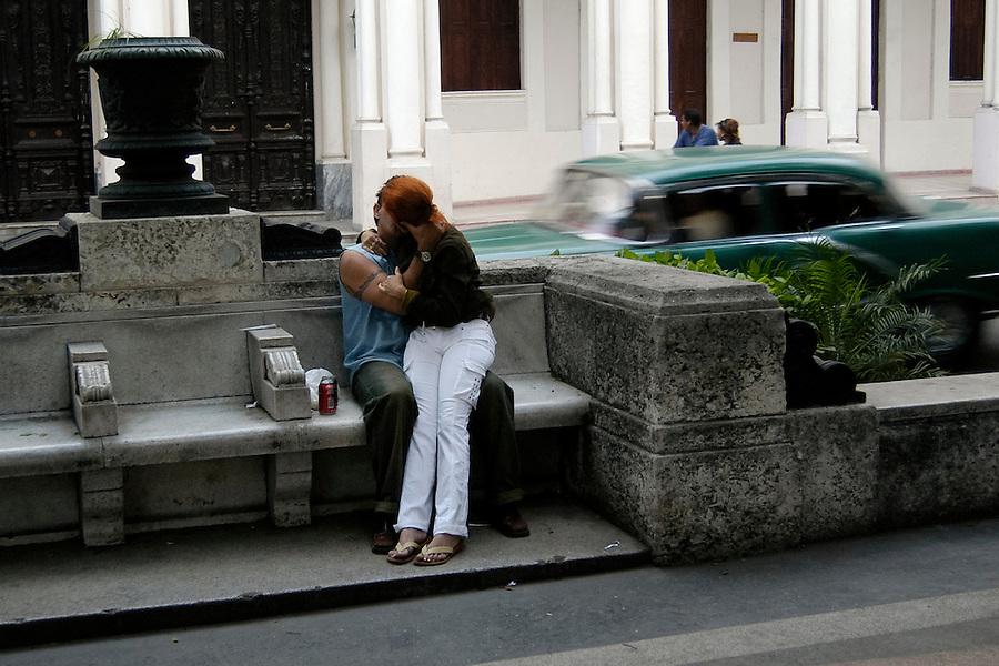 A couple kisses in public at the Prado, a pedestrian mall in Havana, Havana Province of Cuba, on Jan. 11, 2004.