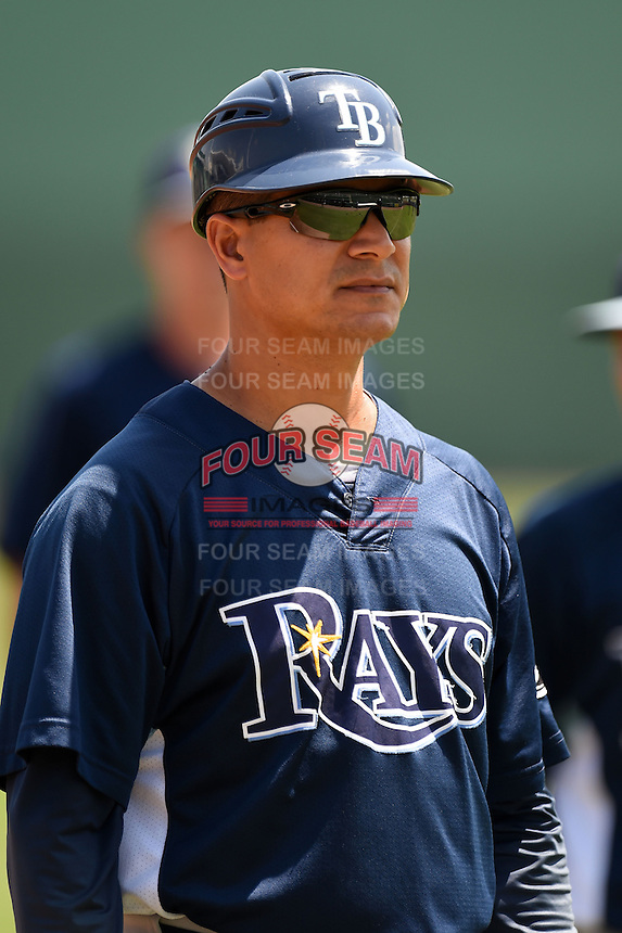 GCL Rays hitting coach Wuarnner Rincones (44) during warmups before a game against the GCL Red Sox on June 25, 2014 at JetBlue Park at Fenway South in Fort Myers, Florida.  GCL Red Sox defeated the GCL Rays 7-0.  (Mike Janes/Four Seam Images)