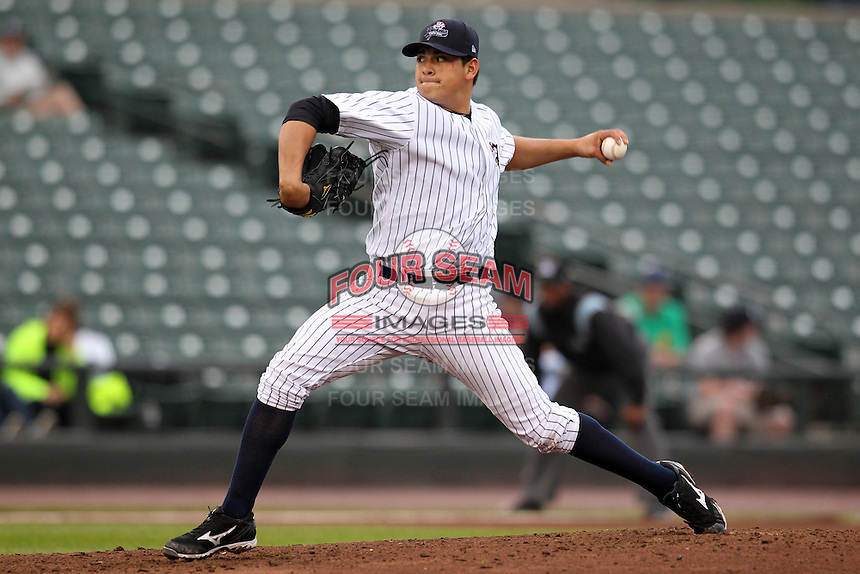 Empire State Yankees starting pitcher Manny Banuelos #13 delivers a pitch during the first game of a double header against the Columbus Clippers at Frontier Field on May 8, 2012 in Rochester, New York.  Columbus defeated Empire State 1-0.  (Mike Janes/Four Seam Images)