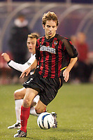 Mike Magee of the MetroStars is watched by Brad Davis of the Burn. The Dallas Burn were defeated by the NY/NJ MetroStars 2-1 on 5/24/03 at Giant's Stadium, East Rutherford, NJ.