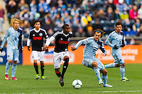 Raymon Gaddis (28) of the Philadelphia Union is marked by Graham Zusi (8) of Sporting Kansas City. Sporting Kansas City defeated the Philadelphia Union 3-1 during a Major League Soccer (MLS) match at PPL Park in Chester, PA, on March 2, 2013.