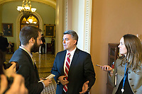 Chair of the National Republican Senatorial Committee, US Senator Cory Gardner (Republican of Colorado) speaks with reporters outside the US Senate chamber after a procedural vote in Washington, D.C. on Friday, December 1, 2017. Photo Credit: Alex Edelman/CNP/AdMedia