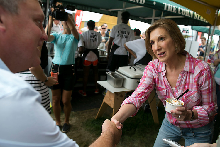 UNITED STATES - August 17: With corn in hand, Republican presidential candidate Carly Fiorina greets supporters at The Corn Stand at the Iowa State Fair in Des Moines, Iowa, Monday, August 17, 2015. (Photo By Al Drago/CQ Roll Call)