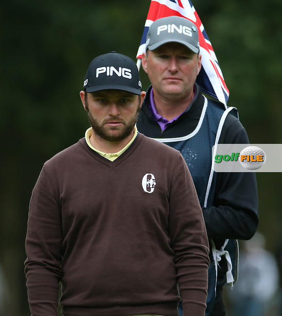 Andy Sullivan(ENG) and caddie Macca check out the line of putt on the 10th during the Third Round of the British Masters 2015 supported by SkySports played on the Marquess Course at Woburn Golf Club, Little Brickhill, Milton Keynes, England.  10/10/2015. Picture: Golffile | David Lloyd<br /> <br /> All photos usage must carry mandatory copyright credit (&copy; Golffile | David Lloyd)