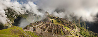 "Morning fog and clouds reveal Machu Picchu, the ancient ""lost city of the Incas"", 1400 CA, 2400 meters. Discovered by Hiram Bingham in 1911. One of Peru's top tourist destinations."